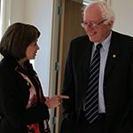 Senator Sanders speaks with a constituent