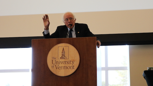 Senator Sanders speaking at podium at the UVM Climate Summit