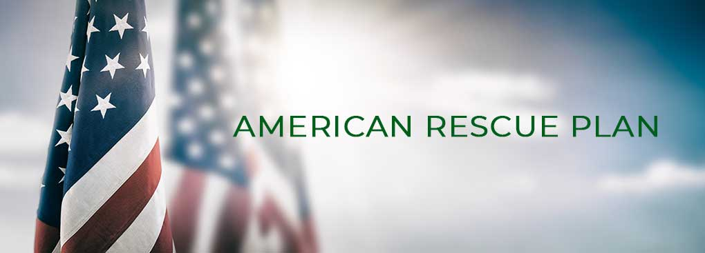 American Rescue Plan title with American flags in the background